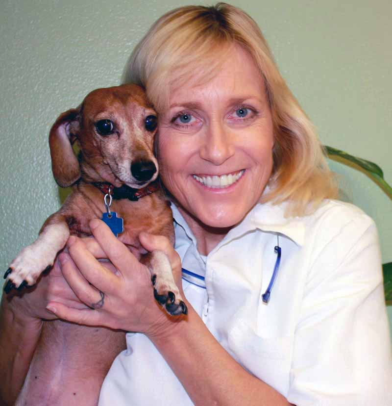 Photo of Dr. Dee Thornell with treated dog.